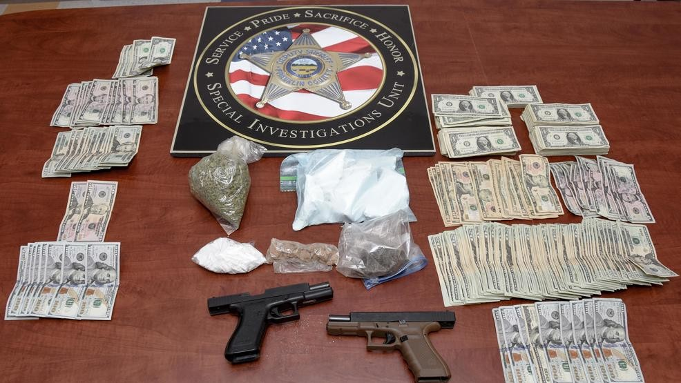 Cocaine, heroin, guns, and cash found during west Columbus drug bust