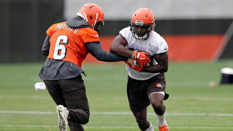 7c7d528c49 Cleveland Browns quarterback Baker Mayfield, left, hands the ball off to  running back D'Ernest Johnson during an NFL football organized team  activity ...
